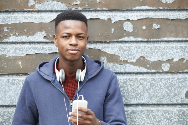 Image of a young man holding a cell phone